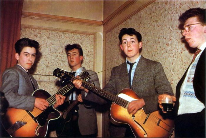 The Beatles in 1957. George Harrison is 14, John Lennon is 16, and Paul McCartney is 15.