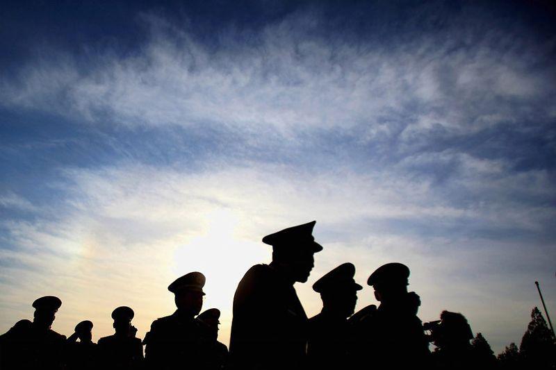 30. Китайская военная делегация направляется на церемонию открытия Всекитайского собрания народных представителей. 5 марта. (Photo by Feng Li/Getty Images)