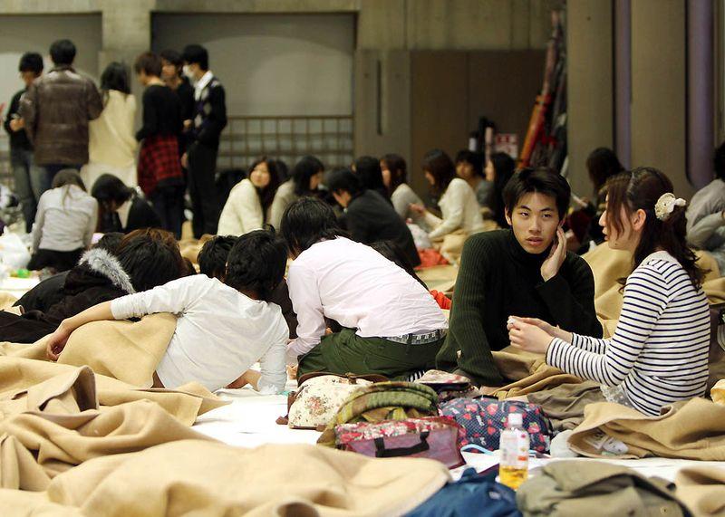 Эвакуированные люди после землетрясения в Токио. (Haruyoshi Yamaguchi/Bloomberg)