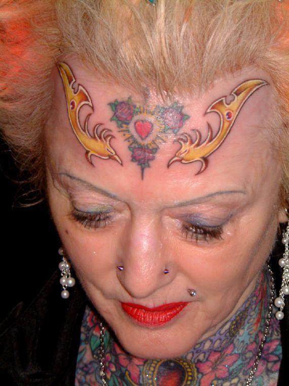 Самая татуированя женщина (28 фото)