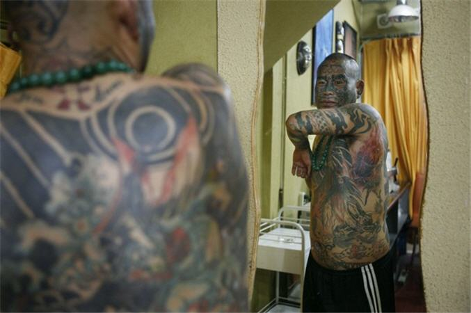 Татуировочный маньяк Лиу Минг (7 фото)