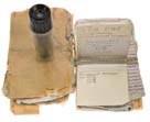 Нижний этаж: задний слой: левый<br> 88. Несколько старых записей в пластмассовой упаковке<br> 89. Пластмассовый пенал с надфилями<br> 90. 10-кратный микроскоп