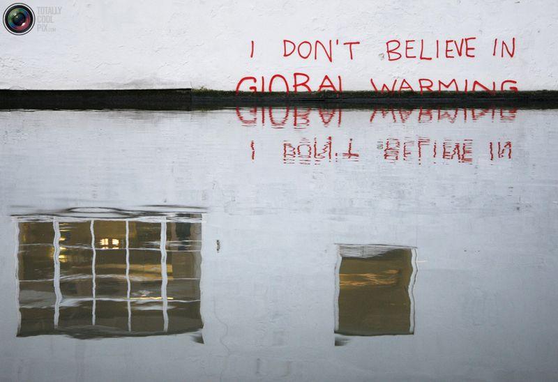 Надпись «Я не верю в глобальное потепление» на стене рядом с каналом Реджент в Кэмдене, Лондон, 22 декабря 2009 года.